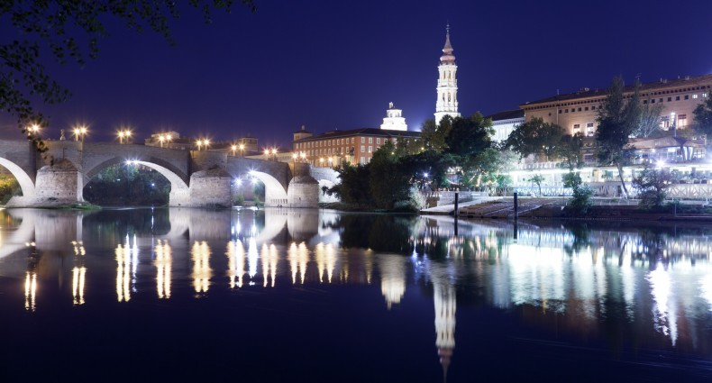 old stone bridge and del Pilar's Basilica in Zaragosa at night
